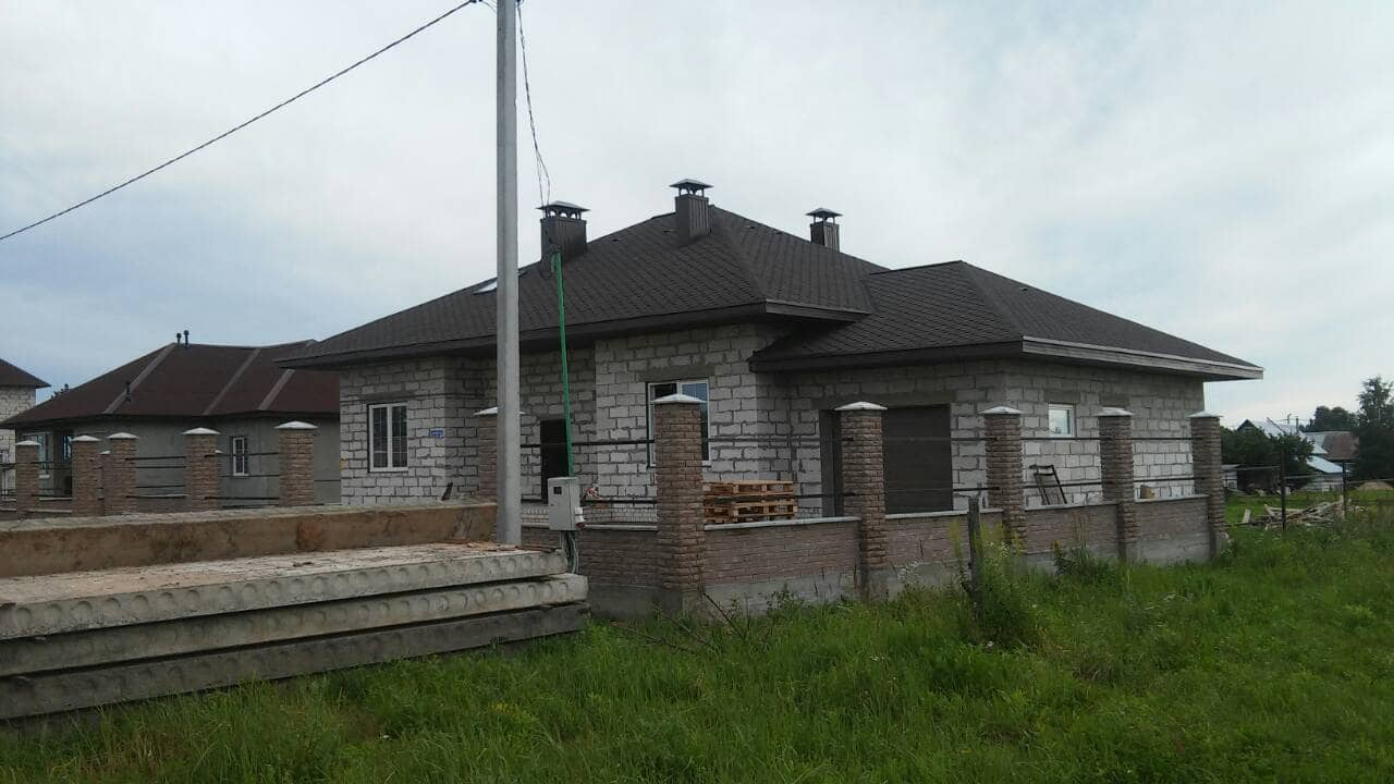 фото построенного дома с гаражом